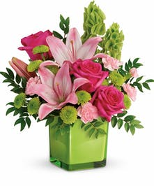 Spring flower design of roses and lilies.