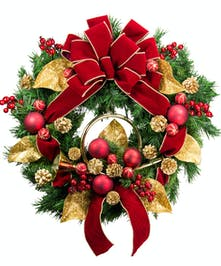 A festive silk holiday wreath featuring gold and red accents and a decorative trumpet.