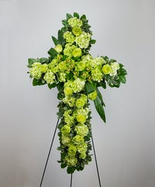 A spiritual tribute for the funeral service designed with all green flowers.