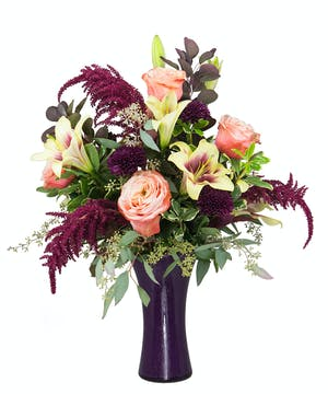 A beautiful fall design full of deep purple and burgundy blooms.