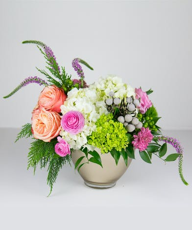 A dazzling winter design with pops of pinks, lavenders and greens!
