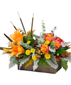 This artistic arrangement will enchant with shades of peach, orange and green.