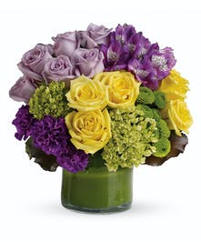 A splendid bouquet of lavender, puprle and yellow spring blooms.