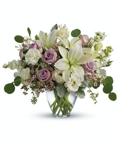 A chic lavender and cream bouquet full of fragrant lilies and roses.