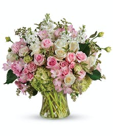 A gorgeous design of premium white and pink long lasting flowers appropriate for any occasion.