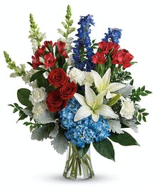 A patriotic bouquet of long lasting red, white and blue blooms.