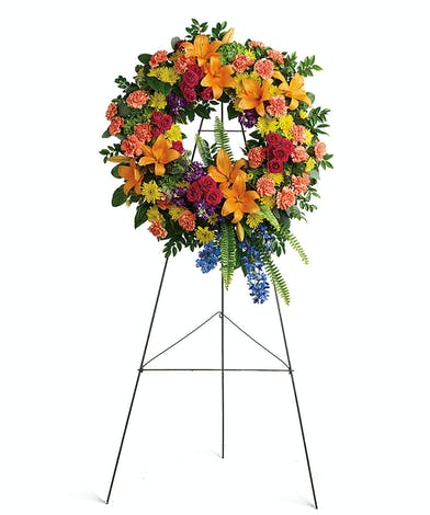 Celebrate the most memorable moments of a beautiful like with this colorful standing wreath.