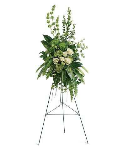 A stylized monochromatic spray of green orchids and white roses.