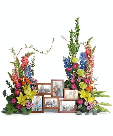 Beautiful bookend bouquets surround precious photographs of memories to never be forgotten.