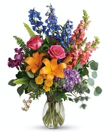 This beautiful bouquet adds a splash of color to any occasion.