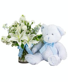 Send flowers to mom and a soft stuffed bear for baby!