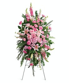 Say farewell with this beautiful pink standing spray featuring an endless array of soft pinks.