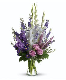 A spectacular lavender and purple vase arrangement appropriate for the home or the service.