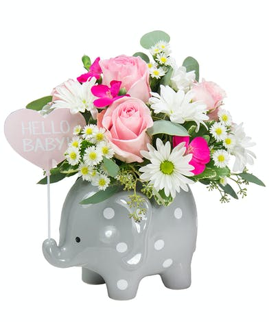 A cute baby elephant flower arrangement for a new baby girl.