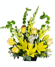 An all yellow sympathy fresh flower design.