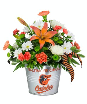 Bright and beautiful Baltimore Oriole's fresh flower arrangement.