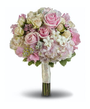 A wonderfully wide variety of soft pink and white blooms make this fragrant bouquet fabulously feminine.