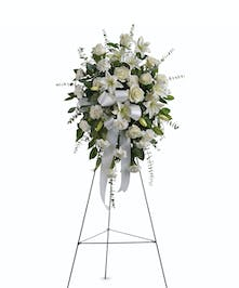 Beautifully simple, this lovely spray of white roses, lilies and carnations.